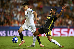 September 19, 2018 - Valencia, Spain - Carlos Soler, Emre Can (R)  battle for the ball during the Group H match of the UEFA Champions League between Valencia CF and Juventus at Mestalla Stadium on September 19, 2018 in Valencia, Spain. (Credit Image: © Jose Breton/NurPhoto/ZUMA Press)