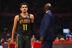 January 28, 2019 - Los Angeles, CA, U.S. - LOS ANGELES, CA - JANUARY 28: Atlanta Hawks Guard Trae Young (11) walks by head coach Lloyd Pierce during a NBA game between the Atlanta Hawks and the Los Angeles Clippers on January 28, 2019 at STAPLES Center in Los Angeles, CA. (Photo by Brian Rothmuller/Icon Sportswire) (Credit Image: © Brian Rothmuller/Icon SMI via ZUMA Press)