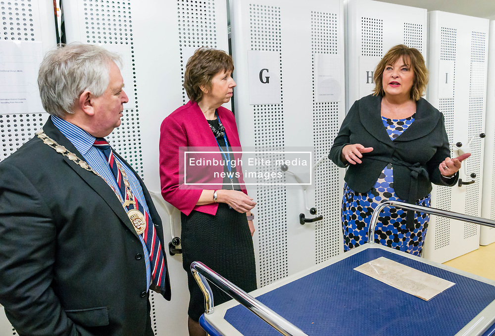 Pictured: Scottish Government Public Libraries Funding Announcement. Culture Minister Fiona Hyslop announces this year's successful bids to the £450,000 Public Library Improvement Fund (PLIF) at the John Grey Centre, Haddington Library, Haddington, East Lothian, Scotland, United Kingdom.  PLIF has been supporting innovative library projects since 2006 which help both individuals and communities. Fiona Hyslop visits the archives of East Lothian to see a letter from Mary Queen of Scots. Pictured: John McMillan, Provost of East Lothian, Depute Chief Executive of East Lothian Council,  Monica Patterson and Fiona Hyslop. 13 December 2018  <br /> <br /> Sally Anderson   EdinburghElitemedia.co.uk