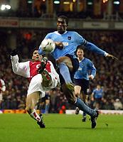 Photo: Scott Heavey.<br /> Arsenal v Manchester City. FA Barclaycard Premiership. 01/02/2004.<br /> Jose Reyes attempts to tackle Sylvain Distin