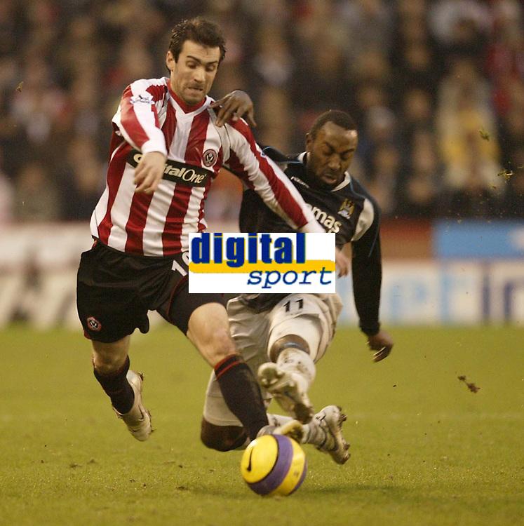 Photo: Aidan Ellis.<br /> Sheffield United v Manchester City. The Barclays Premiership. 26/12/2006.<br /> City's Darius Vassell (R) tackles Sheffield's  Keith Gillespie