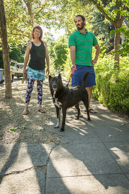 """""""We collect sticks and toss them in the river for Athena.  Since my fall and brain injury in October, Athena has been great therapy for me.""""  Lisa Humphry and Adam Remington with 18 month old """"loaner dog"""", Athena, on Cedar Street in Calistoga."""