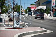 An octopus-shaped bike rack, one of four pieces of art commissioned by the city for 4th street between Roosevelt and Miller Avenues in August 2009, lies unused by many of Coeur d'Alene's bicyclists.