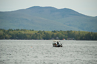 Fisherman looking for that special spot on Lake Winnipesaukee with Mark Island in the distance during the 35th annual Winni Derby Weekend on Saturday.  (Karen Bobotas/for the Laconia Daily Sun)
