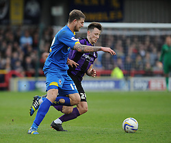 Bristol Rovers' Ollie Clarke and AFC Wimbledon's Harry Pell give chase to the ball - Photo mandatory by-line: Dougie Allward/JMP - Mobile: 07966 386802 05/04/2014 - SPORT - FOOTBALL - Kingston upon Thames - Kingsmeadow - AFC Wimbledon v Bristol Rovers - Sky Bet League Two