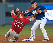 The Angels' Kole Calhoun tries to break up a double play in front of the Dodgers' Enrique Hernandez during their Freeway Series game Friday night at Dodger Stadium.<br /> <br /> <br /> ///ADDITIONAL INFO:   <br /> <br /> freeway.0402.kjs  ---  Photo by KEVIN SULLIVAN / Orange County Register  --  4/1/16<br /> <br /> The Los Angeles Angels take on the Los Angeles Dodgers at Dodger Stadium during the Freeway Series Friday.<br /> <br /> <br />  4/1/16