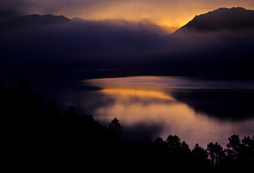 Fog rolling along the landscape of the Lake District.