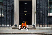 Danny, the son of Labour MP Jess Phillips, on the steps of  Downing Street in London, United Kingdom on 5th July, 2019. He was left there by his mother in protest over schools being forced to close early on Fridays from September because of funding cuts.