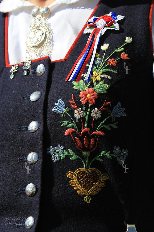 Front of woman's bunad (national costume) is adorned with colorful embroidery at May 17th Constitution Day celebration of nation's independence in Kirkenes, Norway.