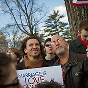 Giovanni Miranda, left and his partner Todd Fernandez, who led a prayer service earlier in the morning traveled from New York City to  demonstrate outside the Supreme Court during the hearings on California's ballot proposition 8, which recognized marriage only between a man and woman.  March 26, 2013. John Boal Photography.