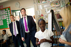 © London News Pictures. 17/07/2013. London, UK.  Deputy Prime Minister NICK CLEGG and Minister of State for Schools, DAVID LAWS talk to year 6 students during a visit to St Joseph's Primary School, in Holborn, London. The Government today (17/07/2013) announced plans to rank students nationally at the age of 11.  Photo credit : Ben Cawthra/LNP