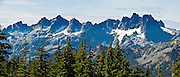 The view from Polalie Ridge in Alpine Lakes Wilderness Area includes Chikamin Peak and Lemah Mountain, Washington, USA. Panorama stitched from 4 photos. Polalie Ridge hike starts from Pete Lake Trailhead near Salmon La Sac Campground, which is 8 miles North of Cle Elum on State Hwy 903, Washington, USA. Panorama stitched from 4 images.