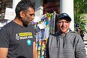 Kumi Naidoo, Secretary General of Amnesty International with Richard Ratcliffe, the husband of detained Nazanin Zaghari Ratcliffe, on day 13 of his hunger strike outside the Iranian Embassy in Knightsbridge, London, United Kingdom on 27th June 2019. Mr Ratcliffe began his protest on June 15 at the same time his wife went on hunger strike in Iran, where she has been detained in prison since April 2016.