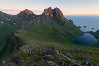 Gjerdtind mountain peak catches last light above Stokkvika bay, Moskenesøy, Lofoten Islands, Norway