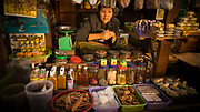 Woman vendor selling spices at the at the Nyaung U Market in Bagan, Myanmar. This market is one of the main tourist attractions in Bagan. It enchants visitors by its unique and lively atmosphere with colorful displays of fruit, flowers, and textiles