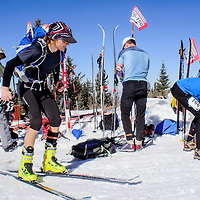 Racers make the ski and snowshoe transition near the summit of Mount Taylor during the 33rd annual Mount Taylor Quadrathlon in Grants Saturday.