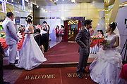 08 MARCH 2006 - HO CHI MINH CITY, VIETNAM: Couples gather in front of a wedding chapel in Ho Chi Minh City, Vietnam. HCMC is still widely known as Saigon. PHOTO BY JACK KURTZ