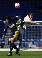 Photo: Greig Cowie.<br /> 13/09/2003.<br /> Nationwide League Division 1. Wimbledon v Wigan Athletic, Selhurst Park.<br /> Rob Gier and Geoff Horsfield compete in the air