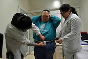 China's fattest man loses 13 stone after being humiliated when he was wheeled through the streets on a reinforced trolley when he tipped the scales at 35 STONE<br /> <br /> The fattest man in China has lost 13 stone so far in a battle to bring his weight under control.<br /> <br /> Liang Yong, 26, was last seen being transported on a steel reinforced trolley to carry his huge weight as he could not fit in an ambulance.<br /> <br /> <br /> The 26-year-old, who officially weighed in at more than 35 stone, went on a diet after he set the unwelcome record five years ago<br /> He said he wanted to lose the weight gradually and avoid crash diets so his skin would shrink back naturally. <br /> <br /> He said: 'It was not a record to be proud of when I was named the fattest man in China and was told it was officially registered at the Chinese record headquarters in 2007, but now I'm hoping to end up as the man who lost the most weight.' <br /> Now weighing a comparatively healthy 22 stone, he is happy to get on the hospital scales in Chongqing, south-western China.  <br /> He said: 'I concentrated on a healthy diet, and regular exercise as soon as I was able to move well enough.'<br /> <br /> Mr Yong said his original weight problem was caused by him being born heavy, weighing in at 11 lbs, and that he had simply continued growing since then.<br /> At three months of age, he weighed 1 stone 8lbs; at three he weighted 4 stone 10lbs; at eight 12 stone 8lbs; and by the time he was 14 he weighed 28 stone 4lbs. <br /> <br /> He was taken to a local hospital which agreed to treat him free of charge in order to monitor his progress medically and record data.<br /> The information will be used to help treating other obese patients in a country where the problem of being overweight is fast becoming a serious issue. <br /> ©Exclusivepix Media