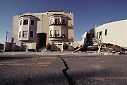 Aftermath of the October 17, 1989 Loma Prieta Earthquake, San Francisco, California. Damage in the Marina District of San Francisco resulting from the earthquake that occurred at 5:04 PM and lasted 15 seconds. At a magnitude of 7.1, it was the worst earthquake in the San Francisco Bay Area since 1906. The earthquake left parts of San Francisco without power for four days; at least 27 fires broke out across the city, a four-foot tsunami wave traveled from Santa Cruz (which also suffered considerable damage to its downtown structures) to Monterey, and in Oakland parts of the Cypress Structure freeway collapsed onto each other.