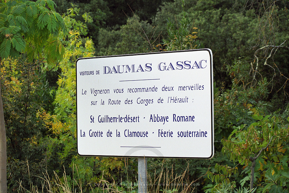 A sign at the Mas de Daumas Gassac recommending visitors to the vineyard to visit other tourist sites, Languedoc, Herault, Languedoc-Roussillon, France