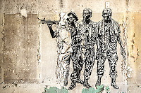 An old mural of the three Vietnam soldiers inside the abandoned Chanute Air Force Base.