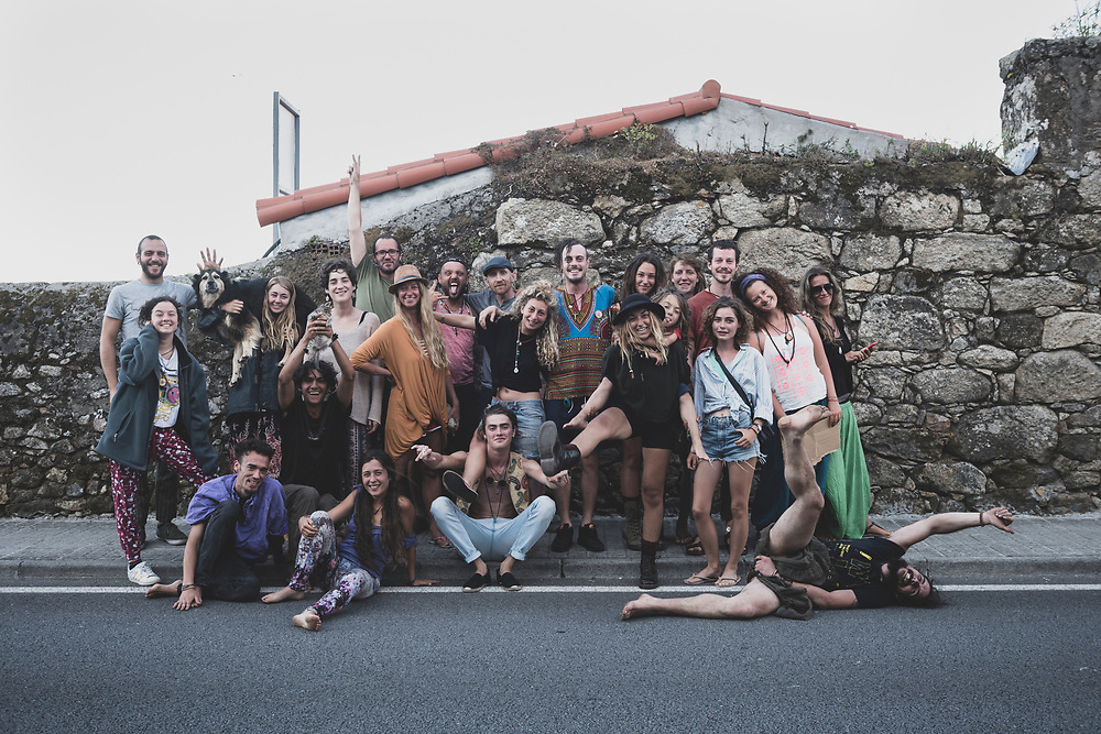 While eating at the World Family Cafe in Finisterre, I asked if there was anyone inside willing to be quickly photographed outside. Almost the whole cafe emptied out across the street for this group picture. (July 22, 2018)<br /> <br /> DAY 56: STAYED IN FINISTERRE