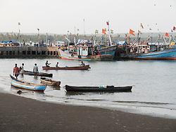 Fishing boats and canoes at Chapora Port, Goa