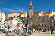 Tartini Square and statue with St Georges Church behind. Piran , Slovenia Visit our PHOTO COLLECTIONS OF SLOVANIAN  HISTOIC PLACES for more photos to download or buy as wall art prints https://funkystock.photoshelter.com/gallery-collection/Pictures-Images-of-Slovenia-Photos-of-Slovenian-Historic-Landmark-Sites/C0000_BlKhcYWnT4Sites/C0000qxA2zGFjd_k