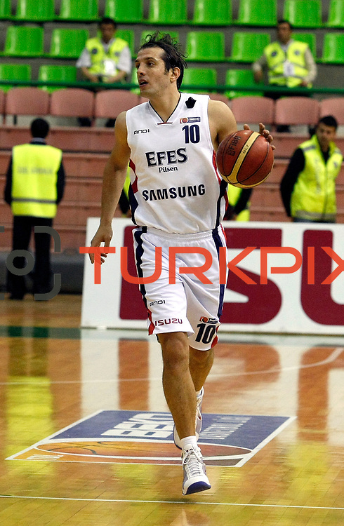 Efes Pilsen's Kerem TUNCERI during their Turkish Basketball league Play Off Final first leg match Efes Pilsen between Fenerbahce Ulker at the Ayhan Sahenk Arena in Istanbul Turkey on Thursday 20 May 2010. Photo by Aykut AKICI/TURKPIX