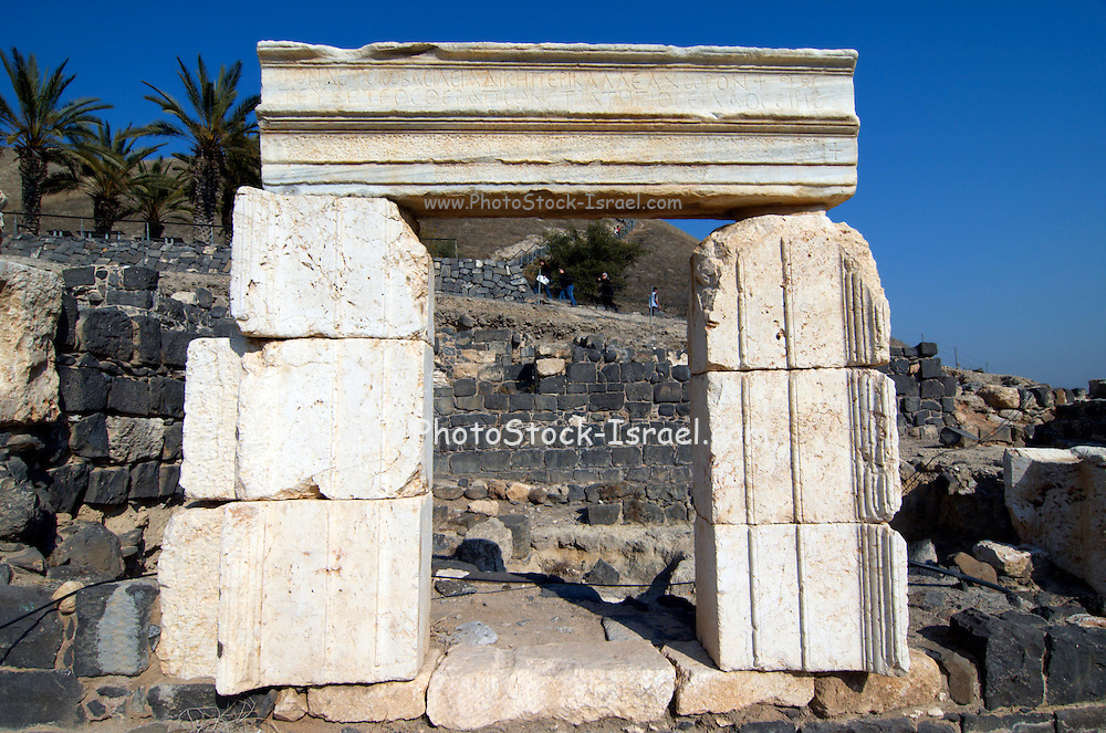 """Israel, Bet Shean a door way with Greek inscription. During the Hellenistic period Bet Shean had a Greek population and was called Scythopolis. In 64 BCE it was taken by the Romans, rebuilt, and made the capital of the Decapolis, the """"Ten Cities"""" of Samaria that were centers of Greco-Roman culture. The city contains the best preserved Roman theater of ancient Samaria as well as a hippodrome, cardo, and other trademarks of the Roman influence. Excavations at the cite are ongoing at the site and reveal no less than 18 successive ancient towns"""