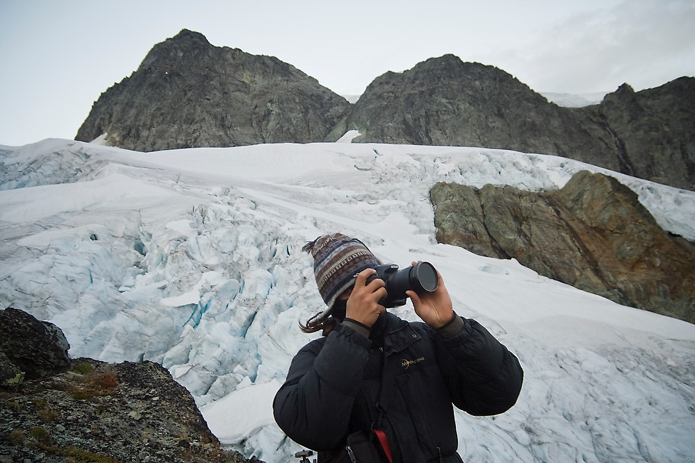 Kevin Steffa takes pictures at dusk below the summit of Mount Shuksan, North Cascades National Park, Washington.