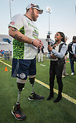 US Olympic gymnast Simone Biles interviews a wounded warrior before the Wounded Warrior Amputee Football Team game against NFL Alumni, at Delmar Stadium, February 1, 2017.