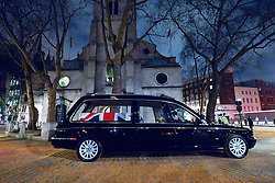© Licensed to London News Pictures. 15/04/2013. London, UK The hearse that will carry the coffin arrives at St Clement Danes Church. A full rehearsal of the funeral of former British Conservative Prime Minster Baroness Thatcher takes place in central London. Hundreds of members of the armed forces drawn from all three services took part in the practice in the early hours of 15th April 2013. Photo credit : Stephen Simpson/LNP