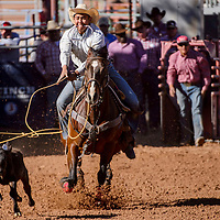 Rooster Yazzie competes in calf roping during the High School Finals rodeo Friday at Red Rock Park in Gallup.