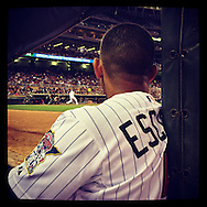An Instagram of Eduardo Escobar of the Minnesota Twins watching from the dugout steps against the Detroit Tigers at Target Field in Minneapolis, Minnesota.