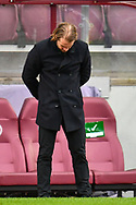 Heart of Midlothian manager Robbie Neilson looks dejected during the SPFL Championship match between Heart of Midlothian and Queen of the South at Tynecastle Park, Edinburgh, Scotland on 27 March 2021.