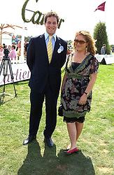LORD FREDERICK WINDSOR and MISS SOPHIE EDDLESTONE at the 2004 Cartier International polo day at Guards Polo Club, Windsor Great Park, Berkshire on 25th July 2004.