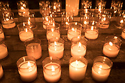 Candles in the Bastia Cathedral in the Citadelle on 16th September 2017 in Bastia, Corsica, France. Candles play an important role in the Catholic Church. For instance, they are lit on the Altar during mass, and for Sacraments. Bastia is a French commune in the Haute-Corse department of France located in the north-east of the island of Corsica at the base of Cap Corse. Bastia is the principal port and commercial town of the island. The inhabitants of Bastia are known as Bastiais or Bastiaises. Bastia Cathedral Pro-cathédrale Sainte-Marie de Bastia is a former Roman Catholic cathedral in Bastia on the island of Corsica, and a national monument of France. The former Bastia Cathedral, dedicated to Saint Mary, was built from 1495 onwards, with major reconstruction at the beginning of the 17th century. Behind the church stands the chapel of Sainte-Croix, known for its exuberantly decorated interior and for the figure of Christ des Miracles Christ of the Miracles, venerated by the people of Bastia, and discovered floating in the waters of the Mediterranean in 1428.