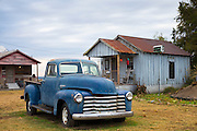 Old Chevrolet 3100 pickup truck, guest cabins at The Shack Up Inn cotton sharecroppers theme hotel, Clarksdale, Mississippi USA