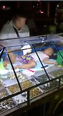 Toddler takes nap lying on food counter