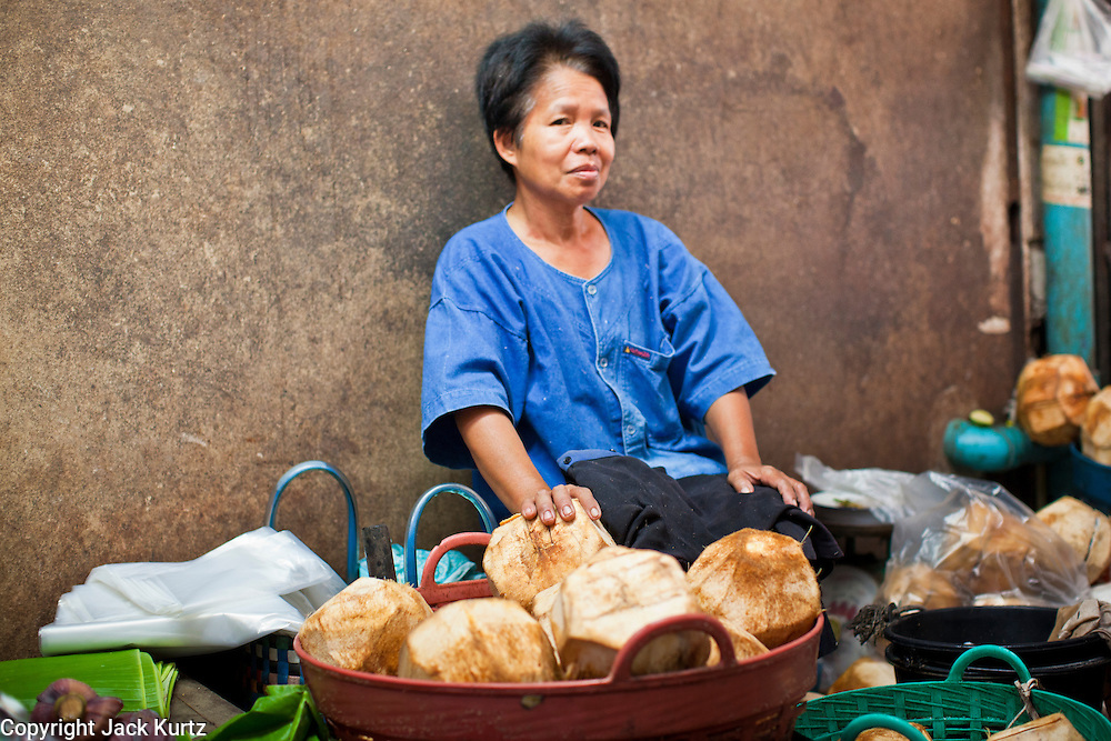 24 JUNE 2011 - CHIANG MAI, THAILAND: A coconut vendor in the market in Chiang Mai, Thailand.  PHOTO BY JACK KURTZ