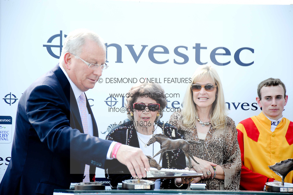 Left to right, BERNARD KANTOR CEO of Investec, CRISTINA PATINO winning owner of Snow Fairy, DALE KANTOR and jockey RYAN MOORE at the Investec Ladies Day at Epsom Racecourse, Surrey on 4th June 2010.