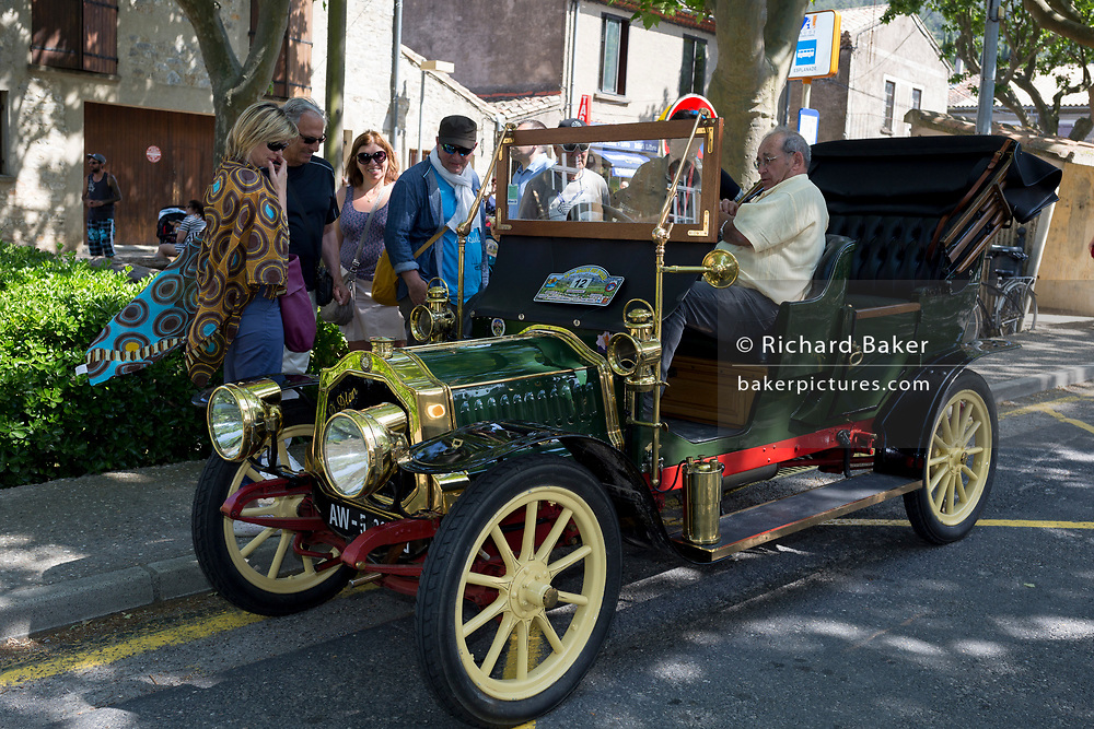 A visiting vintage car in a French village, during a three-day rally journey through the Corbieres wine region, on 26th May, 2017, in Lagrasse, Languedoc-Rousillon, south of France. Lagrasse is listed as one of France's most beautiful villages and lies on the famous Route 20 wine route in the Basses-Corbieres region dating to the 13th century.
