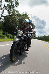 Paul D'Orleans riding Bryan Bossier's 1933 Brough Superior 11-50 with partner and passenger Susan McLaughlin during Stage 1 of the Motorcycle Cannonball Cross-Country Endurance Run, which on this day ran from Daytona Beach to Lake City, FL., USA. Friday, September 5, 2014.  Photography ©2014 Michael Lichter.