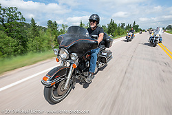 Timothy Knight on his 1995 HD Electra Glide on the Cycle Source ride down Vanocker Canyon back from Nemo to the Iron Horst Saloon during the Sturgis Black Hills Motorcycle Rally. SD, USA. Wednesday, August 7, 2019. Photography ©2019 Michael Lichter.