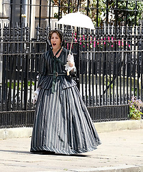 """Moray Place in Edinburgh's Georgian old town was turned into 19th century London for Julian Fellowes' new ITV show """"Belgravia"""".<br /> <br /> Pictured: Tamsin Greig (striped dress) can't stop yawning between takes<br /> <br /> Alex Todd 