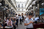 Cafes in an alley off Istiklal Street, one of the most famous avenues in Istanbul, Turkey. Visited by nearly 3 million people in a single day over the course of weekends. Located in the historic Beyoglu district, it is roughly three kilometres long, housing boutiques, bookstores, art galleries, theatres, libraries, cafés and restaurants..The avenue, surrounded by late Ottoman era buildings starts from the medieval Genoese neighbourhood around Galata Tower and ultimately leads up to Taksim Square...Istanbul 7 June 2012