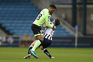 Lewis Grabban of Bournemouth collides into Ben Thompson of Millwall. The Emirates FA Cup 3rd round match, Millwall v AFC Bournemouth at The Den in London on Saturday 7th January 2017.<br /> pic by John Patrick Fletcher, Andrew Orchard sports photography.
