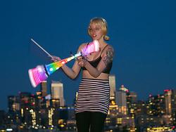 United States, Wasington, Seattle, Gas Works Park, female light artist performing.